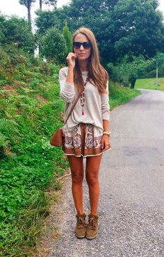 Loose cream sweater, patterned skirt, and moccasin booties