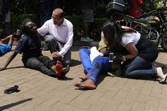 Kenya Terror Attack | Passers by stopped to help injured people after Islamic militants stormed Nairobi's Westgate shopping centre on 21 September taking patrons hostage. Only Muslims who were able to prove their religion were allowed to leave the mall. A Somalian militant group, al-Shabaab, claimed responsibility for the gun attack on Twitter. | AFP / Getty Images/ Buzzfeed