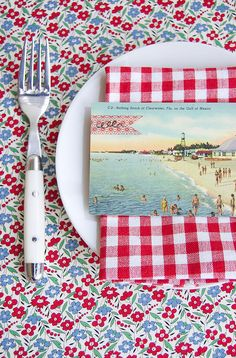 Gingham, flowers, and old postcards-cute Summer table setting!