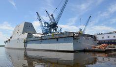 Aft, the USS Zumwalt features a hangar and large flight deck. Royal Navy, Us Navy, Uss Zumwalt, Navy Military, Flight Deck, Navy Ships, Aircraft Carrier, Battleship, Small Towns
