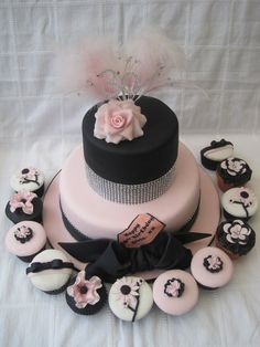 Pink and black wedding cake and cupcakes