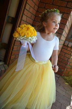 Sunshine yellow tutu for girls. Butter yellow, lemon yellow and ivory tulle is sewn. Flower Girls and portrait tutu skirt.. $90.00, via Etsy.