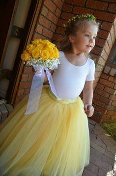 Sunshine yellow tutu for girls. Butter yellow, lemon yellow and ivory tulle is sewn. Flower Girls and portrait tutu skirt.. $90.00, via Etsy.