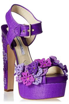 Brian Atwood Karlie plarform sandals. These Spring 2013 sandals feature purple raffia, dark purple leather and laser-cut floral appliqué.