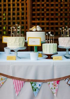 several individual round cakes on stands and decorations