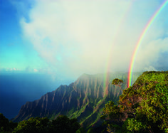 What a sight! A double rainbow arcs above the jagged cliffs and dense vegetation of Kalalau, the largest valley on Na Pali in Hawaii. (photo: Diane Cook)