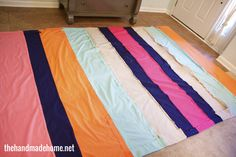 so easy and SO CUTE! Varying widths of fabric sewn together to make bedding. Simply little tutorial!