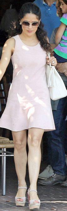 Salma Hayek: Dress – Balenciaga  Purse and shoes – Gucci