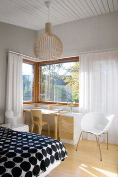 KN: Love the corner window. Light and airy bedroom