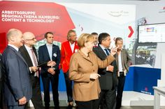 Nationaler IT-Gipfel 2014 Olaf Scholz, Angela Merkel und Sigmar Gabriel auf dem Exponat der RegAG Content & Technology, http://www.pre-view-online.de/?pm_id=4166, photographer: Frank Erpinar, www.erpinar.de