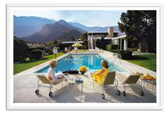 A fine print of the original Slim Aarons photograph, taken in January 1970 at a desert house designed by Richard Neutra for Edgar J. Kaufmann in Palm Springs, CA. Lita Baron approaches, while in...