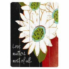 """Paneled wood wall decor with a floral and typographic motif.        Product: Wall decor    Construction Material: Solid wood      Dimensions: 12"""" H x 9"""" W x 0.5"""" D"""