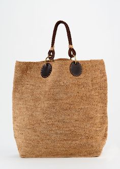 Oversize Raffia Tote   Rodale's The perfect summer bag with natural fiber raffia and leather accents.