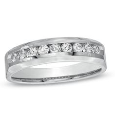 Men's 1/2 CT. T.W. Diamond Wedding Band in 10K White Gold.... Saw 1 CT TW in store