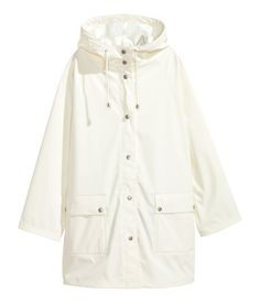 White. Raincoat in water-repellent functional fabric with welded seams. Drawstring hood, snap fasteners at front, and front pockets with flap and snap