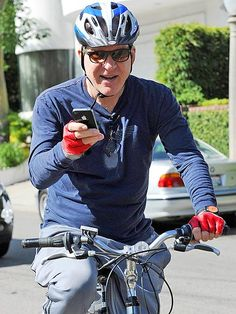 Steve Martin, in chic rectangular sunnies, juggled riding a bike and using his iPhone at once! What a multitasker!