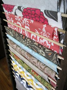 Tutorial on making  this fabric storage - will work great for my quilt tops waiting to be quilted!!  The Project Lady: Fabric Organizer - Wood Frame with Slots for Dowels!