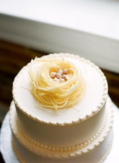 "Birds nest cake topper for ""Feather Their Nest"" bridal shower theme."
