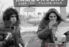 I don't know why I think this is funny, or cool, or whatever but... Eddie Van Halen and David Lee Roth eating outside of a McDonald's.