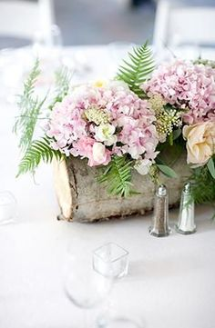 hollowed birch log as centerpiece vase