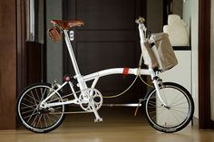 White brompton with Brown brooks saddle - nice look