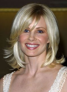 Medium Layered Bob Haircut | Monica Potter's chic shag is fun and sophisticated. To get the look: