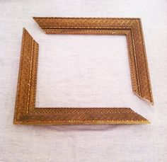 Use an old thrift store frame to frame odd size pieces of art. Cut down two corners with miter saw and then glue and staple together.