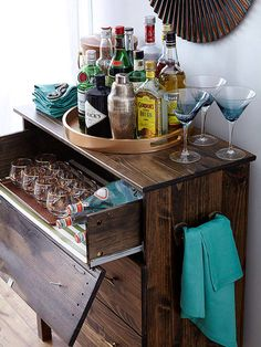 Style Your Drink Station Whether it is a traditional bar, a coffee station, or a water bar, drink stations offer a pretty place to keep glasses or mugs outside of your kitchen cabinets. Start off your drink station with a large tray. Fill the tray with drink items, a set of display-worthy glasses, a pretty container of drink stirrers, or a favorite bowl for citrus wedges. Finally, display some lovely cocktail napkins for texture and practicality.