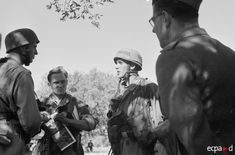 The Italian Campaign, 1943-44: German paratroopers discuss the battle plan, undated. The German parachute regiments fought as infantry both on the East and Western Fronts. The decision originated in Hitler's horror at the paras' heavy casualties during the Battle of Crete (May-June 1941); after Crete, the paras were attached to regular army units until the end of the war.