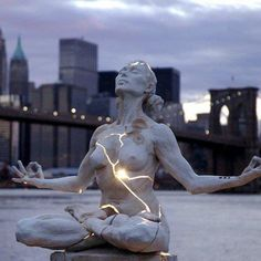 Paige Bradley created one of the most striking sculptures I've seen in recent times. Her masterpiece, entitled Expansion, is a beautiful woman seeking inner piece but fractured and bleeding with light....