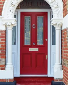 Set inside an ornate pillared stone porch, this elegant red front door and frame with part glazed panelling creates an impressive welcome. The vibrant paintwork is a bold finishing touch to this beautifully crafted Victorian door.