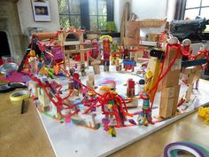 """atelierista: After playing a game where you throw a ball of wool back & forth across a circle of people, forming a web of connections, the children made a sculpture ("""",)"""