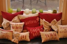 I'm not into the burlap, but I like the idea of a collection of Christmas pillows