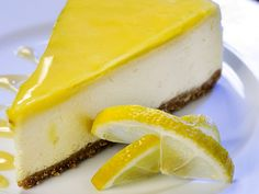A perfect cheesecake recipe with a tangy lemon glaze. Lemon Glazed Cheesecake Recipe from Grandmothers Kitchen. Perfect Cheesecake Recipe, Lemon Cheesecake Recipes, Vanilla Bean Cheesecake, No Bake Oreo Cheesecake, Coconut Cheesecake, Lemon Recipes, Sweet Recipes, Food Cakes, Cupcake Cakes