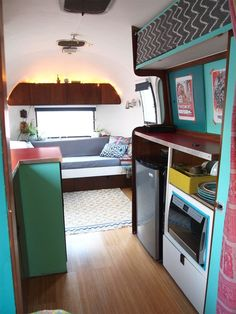 Attention all day-dreamers, travel-lovers and small space dwellers! You'll love this makeover of an Airstream — bought and designed on a tight budget. It's inspiring to those who love color in compact spaces, too!