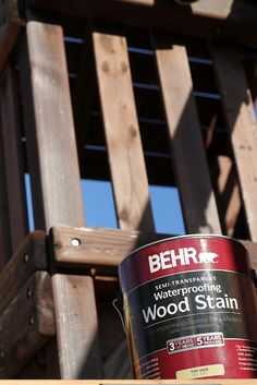 staining a wooden swing set