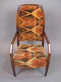 """A French Deco fauteuil in lacquered, carved, and painted beech fauteuil retaining its original geometric patterned chenille upholstery, all in the style of Jacques-Emile Ruhlmann. CIRCA: 1925 DIMENSIONS: 42"""" h x 22"""" x 30"""" d"""