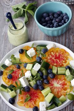 Blueberry tomato cucumber feta salad with mint yogurt dressing