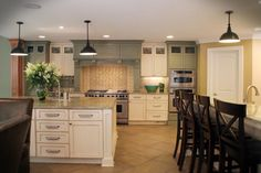 Large, traditional kitchen design with wet bar, island, and colorful kitchen cabinets. Cost details for this kitchen remodel available. Kitchen Floor Plans, Kitchen Redo, Kitchen And Bath, Kitchen Ideas, Kitchen Inspiration, Kitchen Designs, Kitchen Cabinet Colors, Kitchen Colors, Kitchen Cabinets