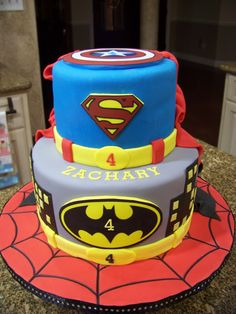 Superhero cake - Spiderman, Batman, Superman & Captain America - Spiderman base, Batman bottom tier, Superman top tier with Captain America shield on top.