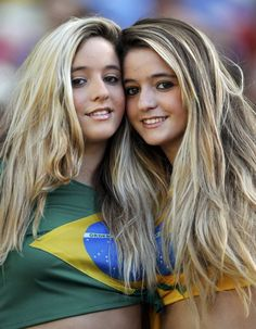 Fans pose for pictures before the Confederations Cup semi-final soccer match between Spain and Italy at the Estadio Castelao in Fortaleza