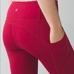 NWT Lululemon All the Right Places Pant Brand new with tags - amazing and flattering pants!  No longer available at Lululemon.  Please note the color of these is raspberry - the first stock photo is courtesy of the Lululemon site to show detailing.  Please see photos for complete description.  No trades please. lululemon athletica Pants Leggings