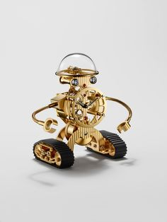 Sherman is an cute mechanical robot desk clock, developed by MB&F (Maximilian Busser & Friends) and crafted by L'Epée that does a wonderful job of Gold Fronts, Robot Design, Mens Gear, Desk Clock, Broken Chain, Telling Time, Luxury Beauty, Creative Words, Watch Sale