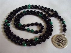 6mm Onyx with Malachite with a Tree of Life Charm : This mala was hand knotted with black silk and we used a Tree of Life charm instead of a tassel.