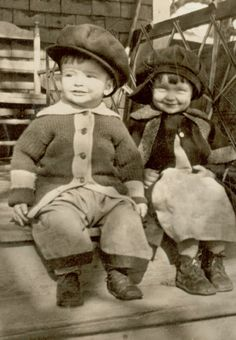Cutie pie brother and sister on front porch ca. 1910