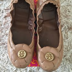 Tory Burch Shelby flats size 7 Lightly loved in good condition. Has normal signs of wear and tear but has a lot of love left to give. Vintage Mestico in sand color with gold hardware. Minor scuffs on leather. Comes in its original box. Tory Burch Shoes Flats & Loafers