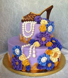 """Grandma's 80th - My friend wanted a cake for her grandmother's 80th birthday. When I asked if she had any particular colors or designs in mind she said, """"She likes lavendar. And she always wears spike high heels. Her favorite pair is leopard print."""" Now THAT'S an 80-year-old I wanna meet!!! LOL Thanks to Millie1957 for the inspiration for the ruffle flowers. When trying to figure out what to coordinate with the shoe, I remembered seeing her fabulous cake and thought those ruffles and jewels…"""