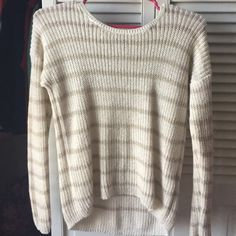 Sweater It has gold and white/cream stripes. Worn once Hollister Sweaters