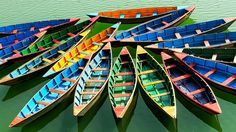 Colourful Boats in Pokhara Lake, Nepal. Best time to go to Pokhara is during winter...