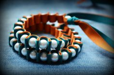 Ribbon and pearl bracelet. Orange and blue would be super cute for gameday!